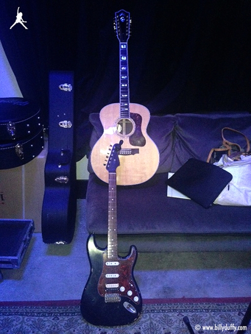 """My jumbo Gibson J-200 acoustic and Nash Relic S-57."""