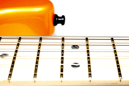 Trastes Dunlop 6105 y marcadores en abalone